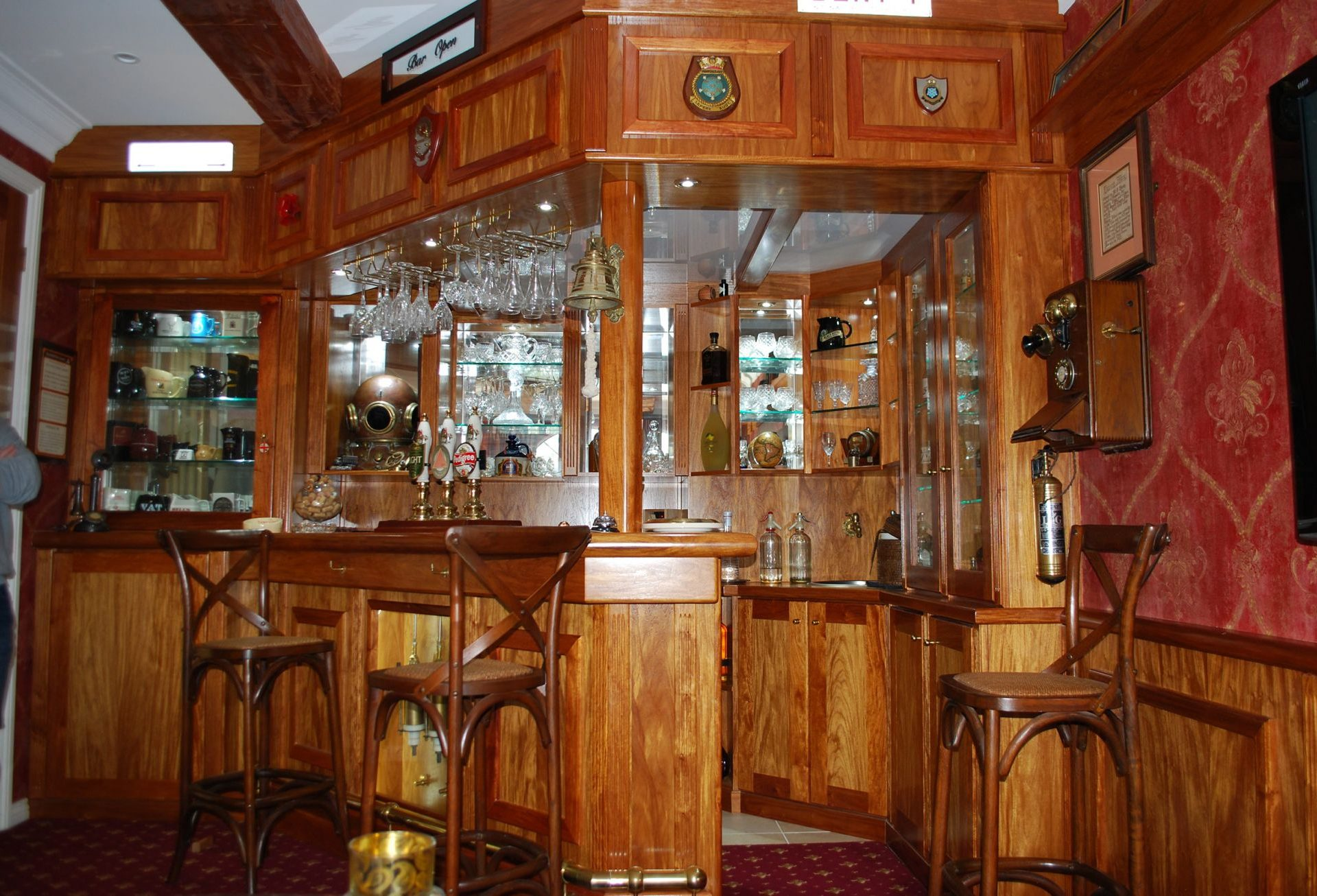Wooden bar with mirror and glass back